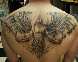Large back and white back tattoo