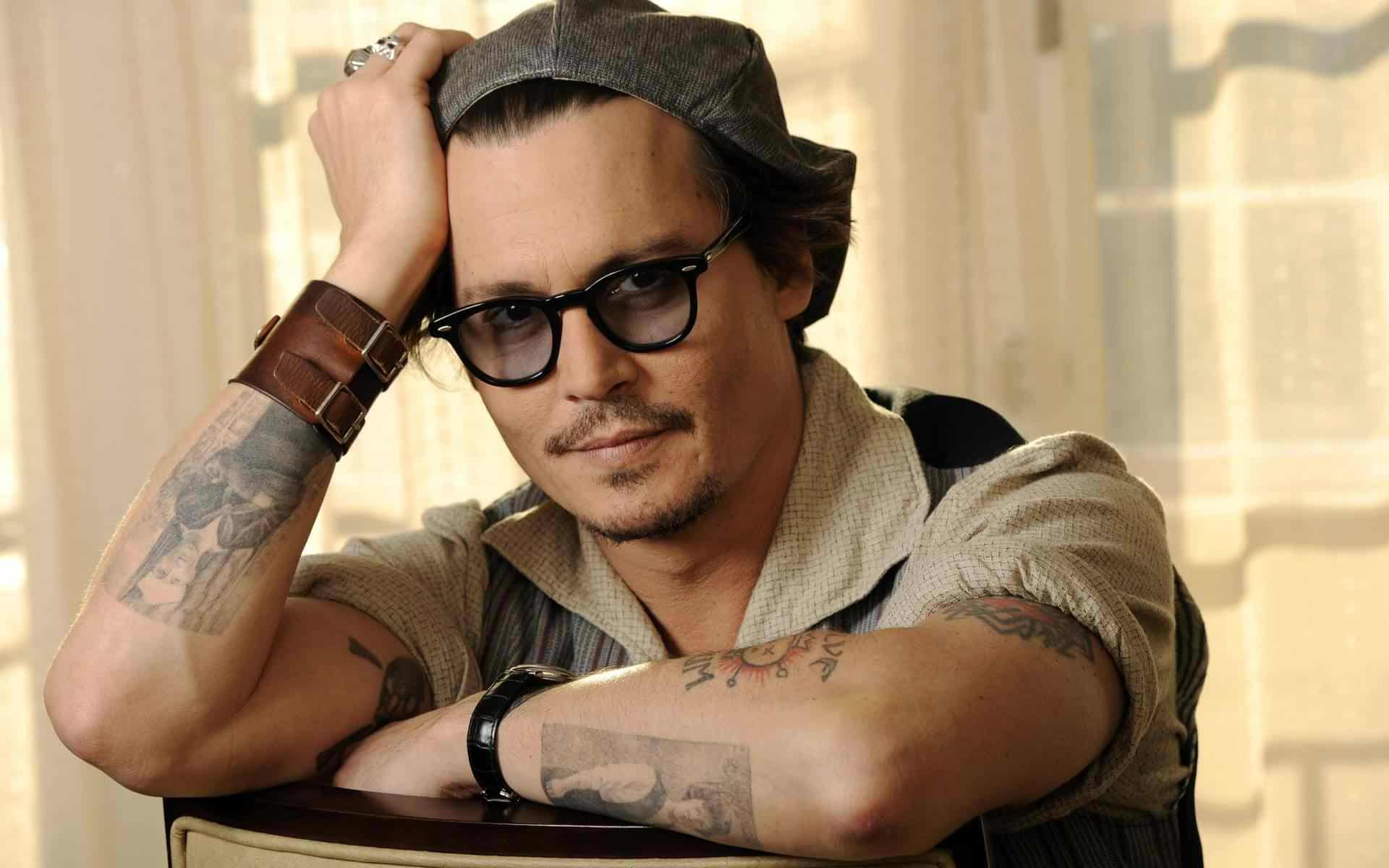 johnny_depp_takes_actor_man_tattoo_19007_1920x1200