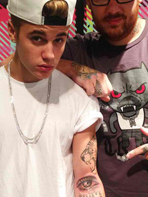 Justin bieber new tattoo the eye after inked tattoo for Justin bieber eye tattoo